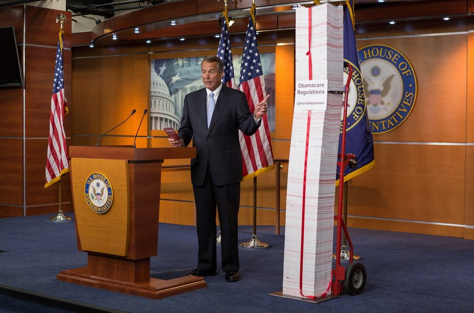 """Speaker Boehner with the """"Red Tape Tower"""" of ObamaCare regulations"""