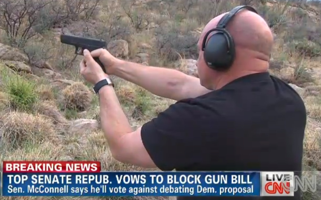 Mark Kelly on CNN in 2013 with his wife's Glock 9mm, the same kind of gun his wife was shot with