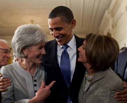 Pres. Obama embraces HHS Sec Kathleen Sebelius, left, and House Speaker Nancy Pelosi after signing the health insurance reform bill, March 23, 2010. (White House photo)