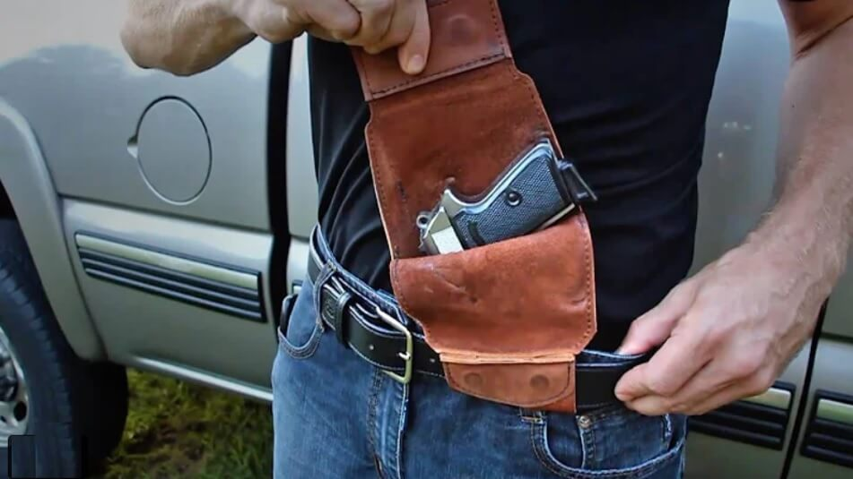 Image of person wearing a gun pouch on his belt.